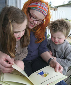 Mother and children reading